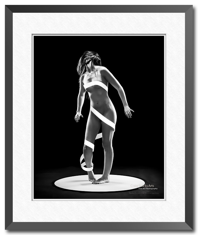 Fine art figure photograph showing a dramatic pose and lighting  by Craig Stocks