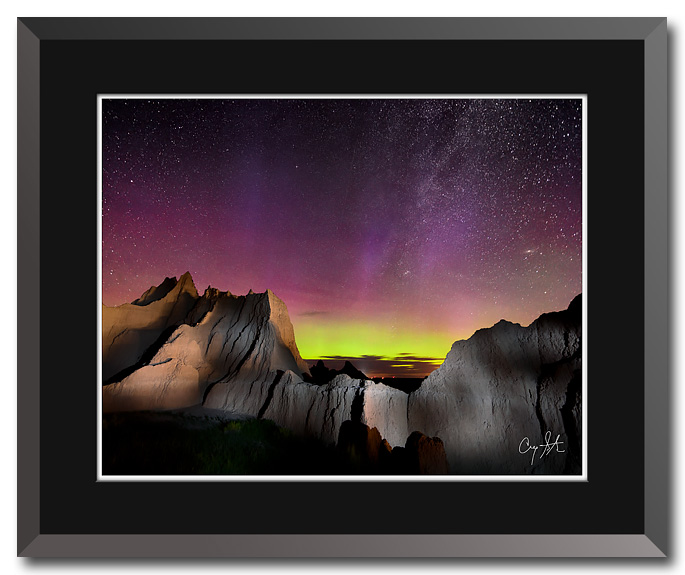 Fine art photo by Craig Stocks showing the colors of northern lights over Badlands National Park