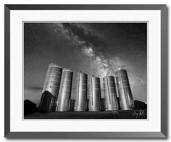 Fine art photograph by Craig Stocks showing the Milky Way over a set of grain silos on a farm in Illinois