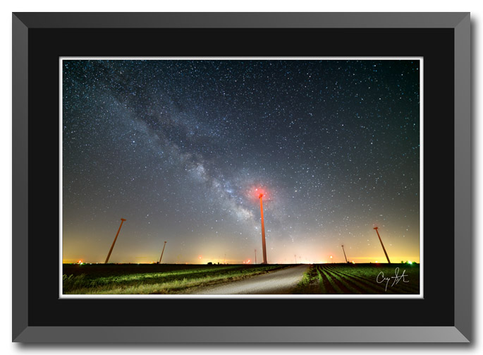 Fine art photo by Craig Stocks showing an Illinois wind farm at night with the Milky Way in the sky
