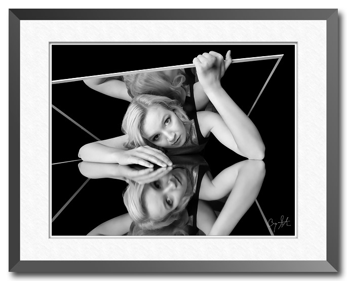 """Kaleidoscope Escape"" - a fine art image by Craig Stocks showing a woman trapped between two mirrors"