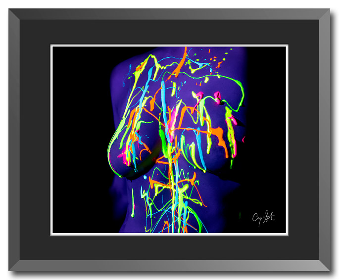 Fine art photo of fluorescent paint on the nude torso of a woman under a black light, photo by Craig Stocks