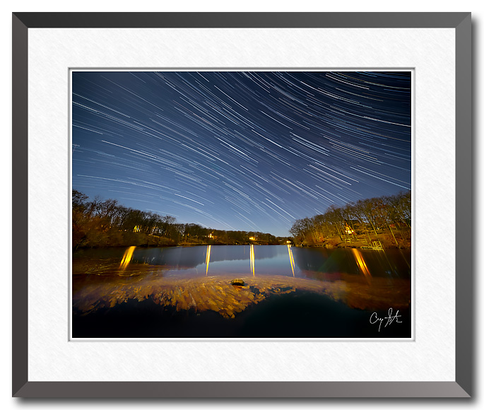 Star trails over a small Midwest lake under moonlight - Fine art photo by Craig Stocks