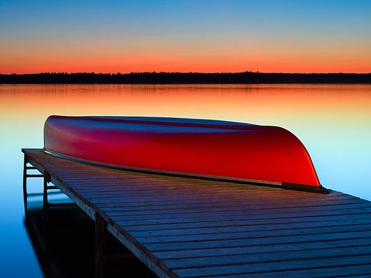 Red canoe at Riding Mountain National Park, Canada