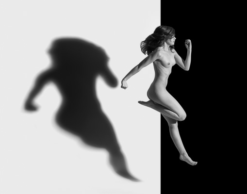 Nude jumping with her own shadow
